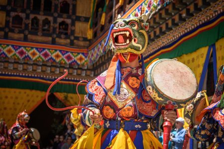 bhutan-monk-dancing-for-colorful-mask-dance-at-yearly-paro-tsechu-festival-in-bhutan